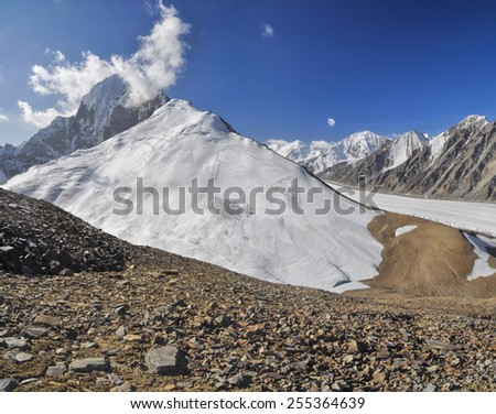 Magnificent glacier in Pamir mountains in Tajikistan - stock photo