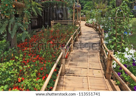 Magnificent huge park on island Madiera. A bamboo path round a fountain - stock photo