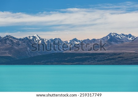 Magnificent Lake Tekapo and snow-capped Southern Alps, Canterbury, New Zealand - stock photo