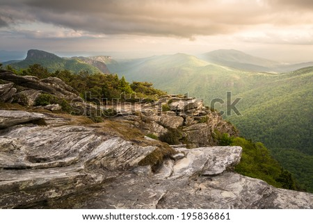 Magnificent light on top of Hawksbill Mountain looking south in to the Linville gorge with Table Rock Mountain in the distance.  - stock photo