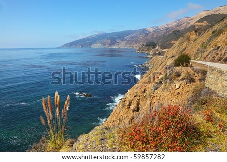 Magnificent mountain road on Pacific coast USA. Bright serene autumn day - stock photo