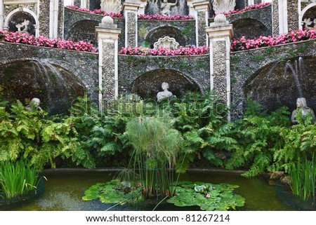 Magnificent palace, pond and fountain in beautiful well-groomed park - stock photo