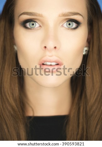 magnificent portrait of a beautiful young woman withblue eyes  - stock photo