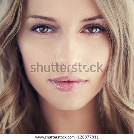 magnificent portrait of a beautiful young woman with perfect skin closeup - stock photo