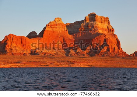 Magnificent red sandstone cliffs on the shores of Lake Powell. Arizona, United States - stock photo