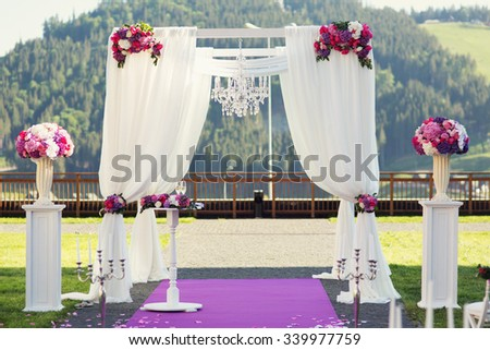 Magnificent romantic wedding purple aisle with mountains in background - stock photo