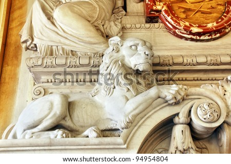 Magnificent sculpted lion part of a marble fireplace mantle of an historical european building, hotel de ville de Lyon, France. - stock photo