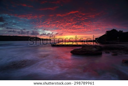 Magnificent sunrise and stunning colour over Malabar ocean rock pool,  in Long Bay, Sydney.   - stock photo