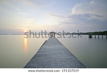 Magnificent sunset and lake reflections at Long Jetty - stock photo
