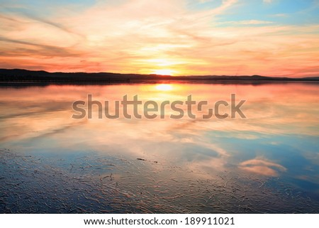 Magnificent sunset and water reflections at Long Jetty, NSW Australia - stock photo