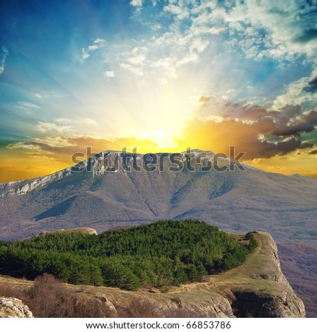 magnificent sunset in a mountains - stock photo