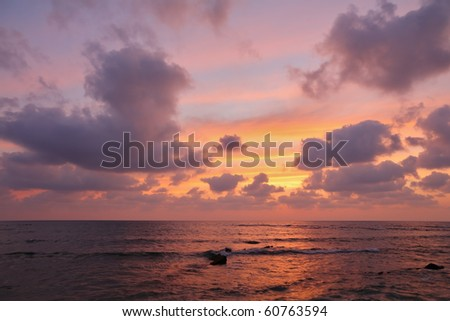 Magnificent sunset on Mediterranean sea. Clouds and reflexions on water - stock photo