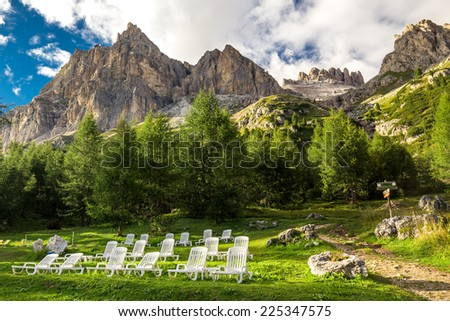 Magnificent valley with Cristallo mountain group near Cortina d'Ampezzo with relaxing chairs in foreground, Dolomites mountains, Italy Europe - stock photo