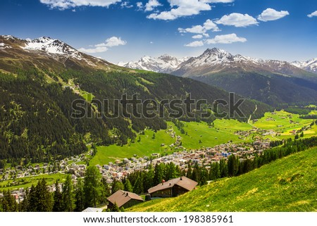 Magnificent valley with Davos city surrounded by Jakobshorn and Rinerhorn  Swiss Alps peaks from the top of the Schatzalp mountain, Grisons, Switzerland - stock photo