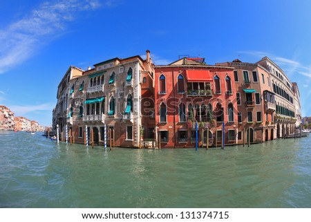 Magnificent Venetian palace on a sunny day, surrounded by the waters of the channel mirror. Photo making the lens Fisheye - stock photo