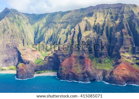 magnificent view at na pali coast at kauai island, hawaii, from helicopter - stock photo