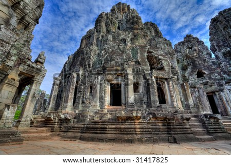 magnificent view at the bayon temple - angkor wat - siem reap - cambodia with blue skye and dramatic clouds (hdr) - stock photo