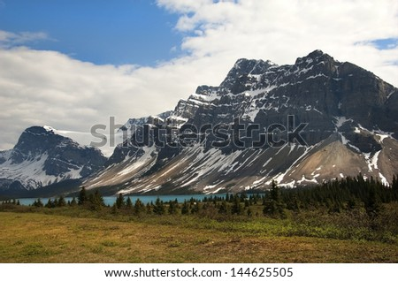 magnificent views of the Canadian Rocky Mountains and glacial lake at the foot of them, Alberta, Canada - stock photo
