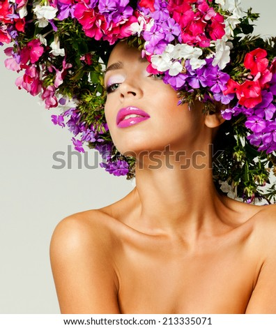 magnificent woman in a hat made �¢??�¢??of flowers - stock photo