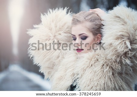 Magnificent Woman in Winter Park - stock photo
