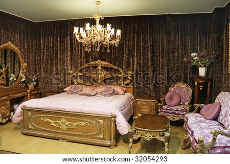 Magnificent wooden bedroom in furniture store - stock photo