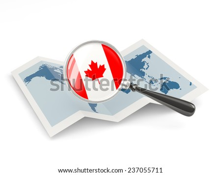Magnified flag of canada with map isolated on white - stock photo