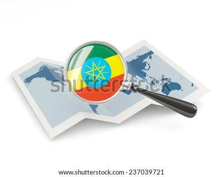 Magnified flag of ethiopia with map isolated on white - stock photo