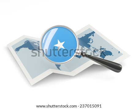 Magnified flag of somalia with map isolated on white - stock photo