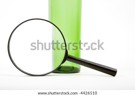 Magnifier and bottle - stock photo