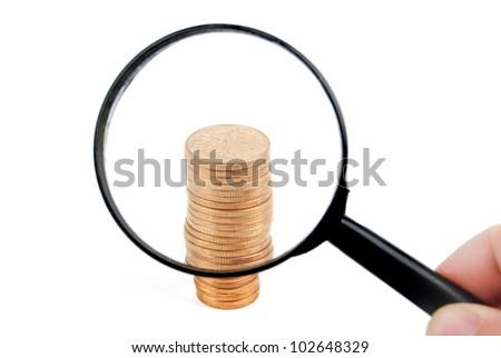 Magnifier and coin - stock photo