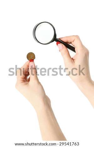 Magnifier and coin in hands isolated on white background