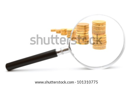 Magnifier and gold coins. On a white background. - stock photo