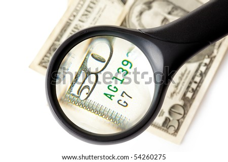magnifier and money on white background