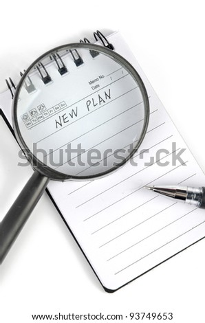 Magnifier and notepad with pen