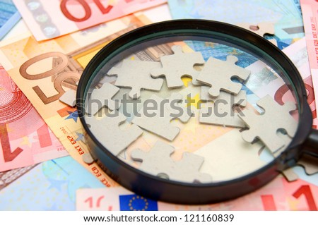 Magnifier and puzzle for euro banknotes. - stock photo