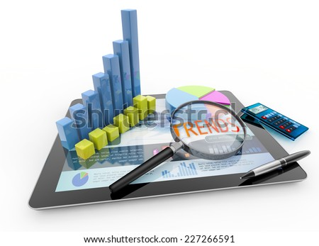 magnifier, charts, calculator and pen on laptop - stock photo