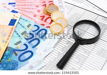 Magnifier, euro and coins on documents. - stock photo