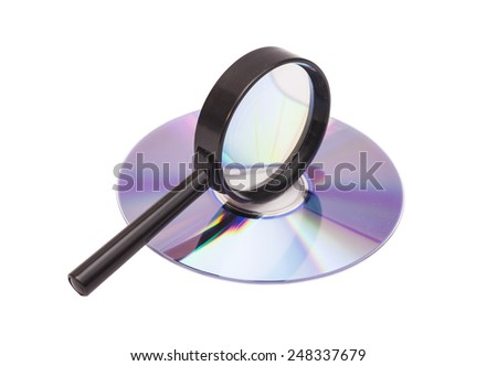 Magnifier glass and DVD  - stock photo