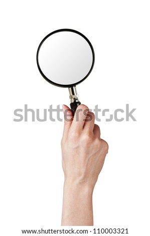 Magnifier glass in woman hand isolated on white background - stock photo