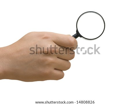 magnifier in hand - stock photo