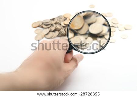 magnifier in men hand - stock photo