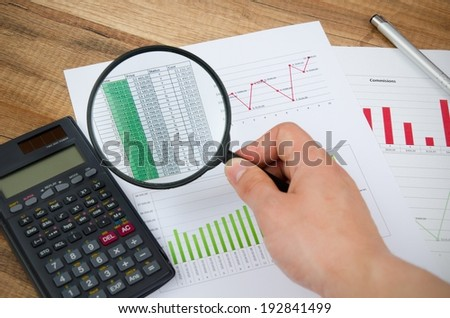Magnifier on business background. Use for company strategic behavior composition - stock photo
