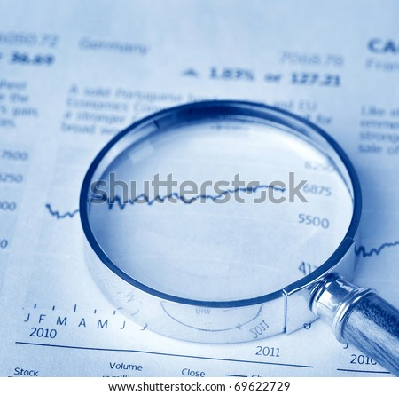 Magnifier on financial statement - stock photo