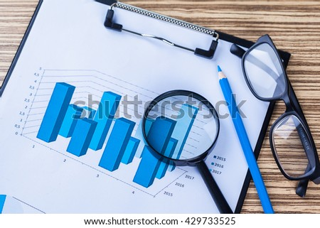 Magnifiers and documents. - stock photo