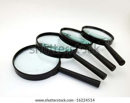Magnifiers or lenses sorted on  clear background - stock photo