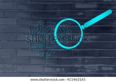 magnifying glass analyzing an electronic circuit brain - stock photo