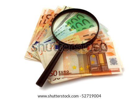 magnifying glass and banknotes isolated on white. Business concept - stock photo