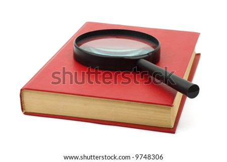 Magnifying glass and book, isolated on white background - stock photo