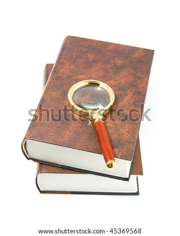 Magnifying glass and books, isolated on white background. - stock photo