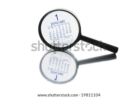 Magnifying Glass and Calendar on White Background